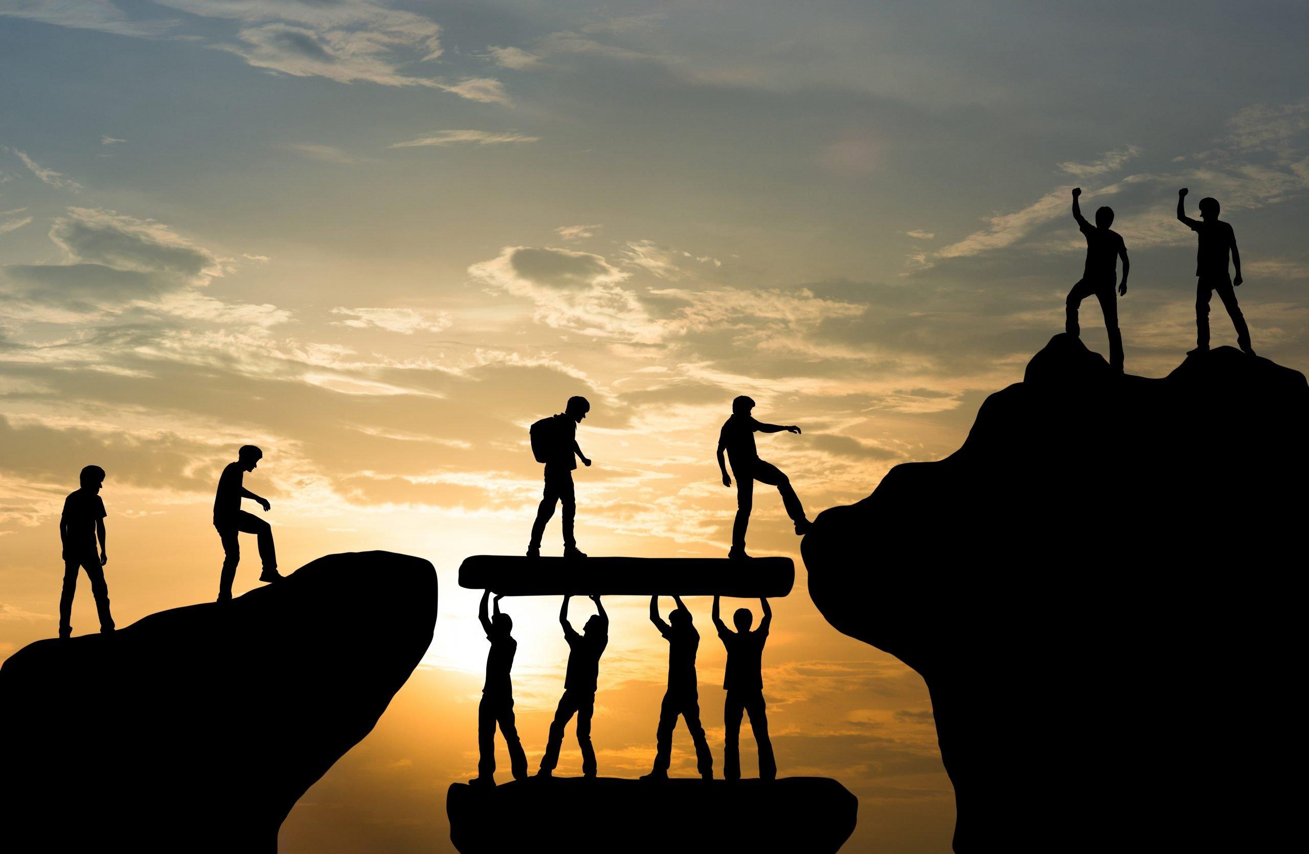 Group,Of,Team,People,Helping,Work,On,Peak,Mountain,Climbing